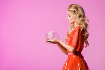 Photo for Beautiful girl posing with lamp isolated on pink, doll concept - Royalty Free Image