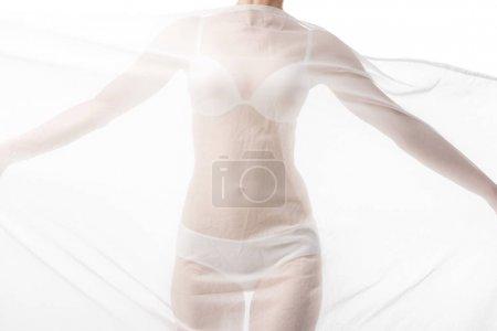 Foto de Vista parcial de la mujer sexy en ropa interior con tela blanca aislada en blanco - Imagen libre de derechos