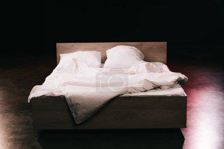Photo pour Soft pillows on white clean bed sheets in bedroom on black - image libre de droit