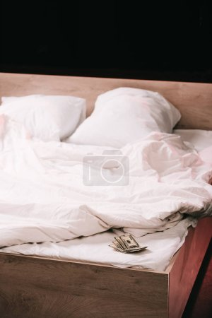 Photo for Selective focus of dollar banknotes on clean bedding isolated on black - Royalty Free Image