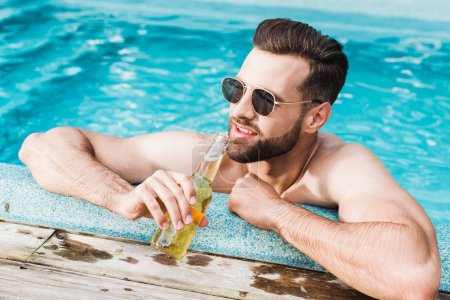Photo for Happy bearded man in sunglasses holding bottle with beer - Royalty Free Image