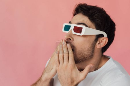 Photo for Shocked muscular man in 3d glasses covering mouth with hands isolated on pink - Royalty Free Image