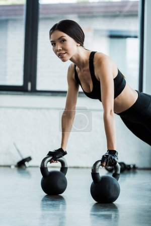 Photo for Beautiful woman  in sportswear exercising with dumbbells - Royalty Free Image