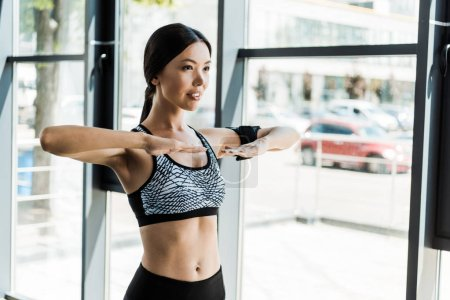 Photo for Happy young athletic woman working out in sports center - Royalty Free Image