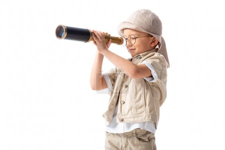 explorer boy in glasses and hat looking through spyglass isolated on white