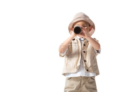 Photo for Explorer boy in glasses and hat looking through spyglass isolated on white - Royalty Free Image