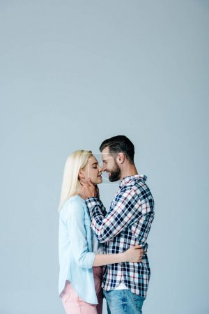 Photo for Beautiful couple hugging and looking at each other isolated on grey with copy space - Royalty Free Image
