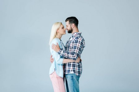 Photo for Beautiful couple hugging and looking at each other isolated on grey - Royalty Free Image