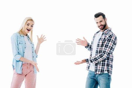 Photo pour Heureux fille et l'homme geste avec ouvert paumes isolé sur blanc - image libre de droit