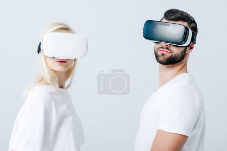 Photo for Man and girl in Virtual reality headsets isolated on grey - Royalty Free Image