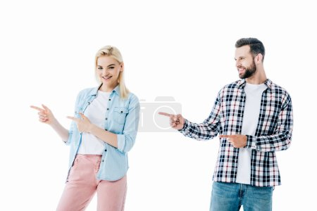 Photo for Smiling girl and man pointing with fingers Isolated On White - Royalty Free Image