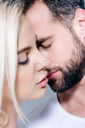 Photo for Beautiful young romantic couple with closed eyes - Royalty Free Image