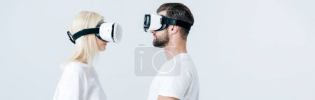 Photo for Panoramic shot of man and girl in Virtual reality headsets isolated on grey - Royalty Free Image