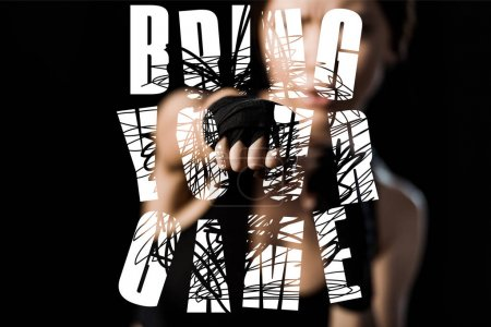 Photo for Selective focus of woman boxing in glove near bring the game lettering isolated on black - Royalty Free Image