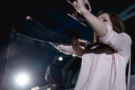 Photo for Thief strangling woman near car at night - Royalty Free Image