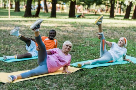 Photo for Senior african american man and women working out on fintess mats - Royalty Free Image
