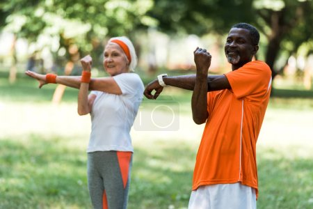 Photo for Selective focus of happy senior african american man working out with retired woman - Royalty Free Image