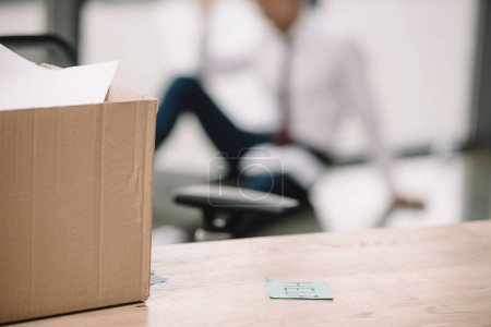 Photo for Selective focus of carton box near sticky note with help lettering on table - Royalty Free Image