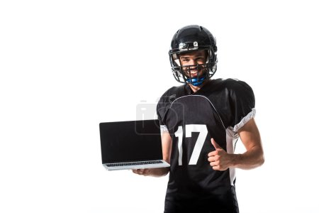 Photo for American Football player with laptop showing thumb up Isolated On White - Royalty Free Image