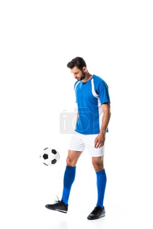 Photo for Handsome soccer player training with ball Isolated On White - Royalty Free Image