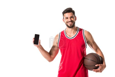 Photo for Basketball player holding smartphone with blank screen Isolated On White - Royalty Free Image