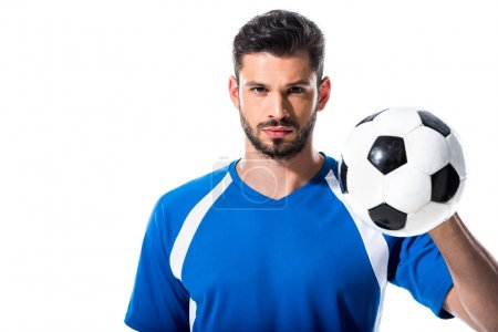 Photo for Handsome soccer player looking at camera and holding ball Isolated On White - Royalty Free Image