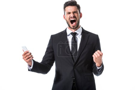 Photo for Yelling businessman with smartphone and clenched hand Isolated On White - Royalty Free Image