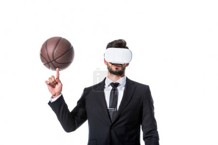 Photo for Businessman in Virtual reality headset spinning on finger basketball Isolated On White - Royalty Free Image