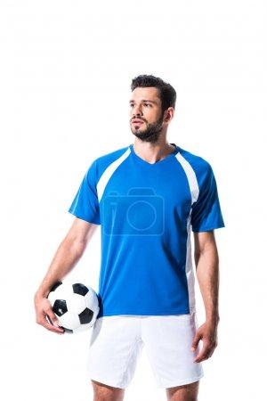 Photo pour Footballeur avec ballon regardant loin isolé sur blanc - image libre de droit