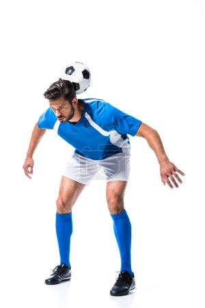 Photo for Soccer player training with ball on back Isolated On White - Royalty Free Image
