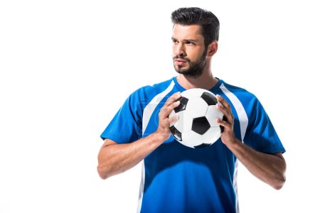 Photo for Handsome soccer player with ball looking away Isolated On White - Royalty Free Image