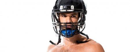 Photo pour Tir panoramique de joueur de football américain torse nu dans le casque isolé sur le blanc - image libre de droit