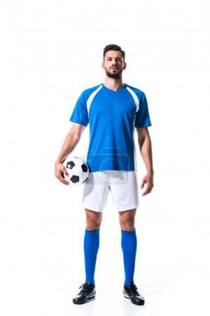 Photo pour Beau joueur de football en uniforme avec ballon isolé sur blanc - image libre de droit