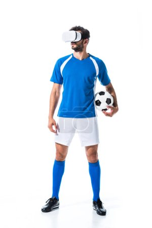 Photo for Soccer player in virtual reality headset holding ball Isolated On White - Royalty Free Image