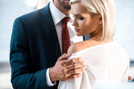 Photo for Cropped view of man touching shoulder of attractive woman in office - Royalty Free Image
