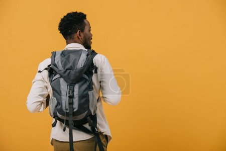 Photo for African american man standing with backpack isolated on orange - Royalty Free Image