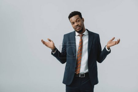 Photo for Handsome african american man showing shrug gesture isolated on grey - Royalty Free Image