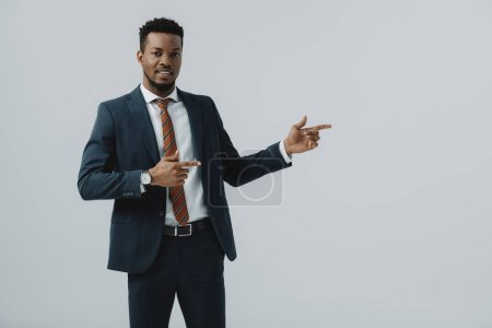 Photo for Cheerful african american man pointing with fingers isolated on grey - Royalty Free Image