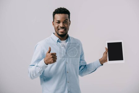 Photo for Happy african american man showing thumb up and holding digital tablet with blank screen isolated on grey - Royalty Free Image