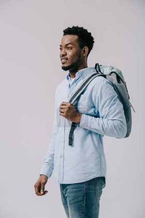 Photo for Curly african american man standing with backpack isolated on grey - Royalty Free Image
