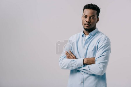 Photo for Handsome african american man looking at camera and standing with crossed arms isolated on grey - Royalty Free Image