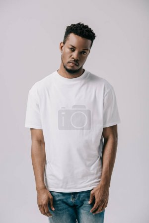 Photo for African american man standing and looking at camera isolated on grey - Royalty Free Image