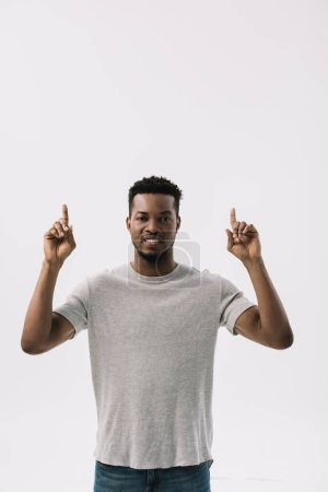 Photo for Happy african american man pointing with fingers and smiling isolated on white - Royalty Free Image