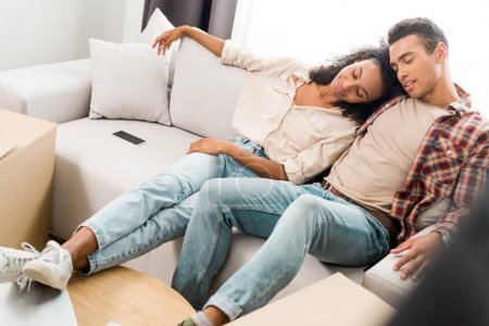 Photo for Full length view of african american wife and husband sleeping while sitting on sofa - Royalty Free Image