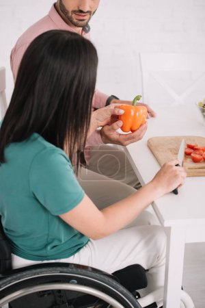 Photo for Partial view of disabled young woman preparing salad together with boyfriend - Royalty Free Image
