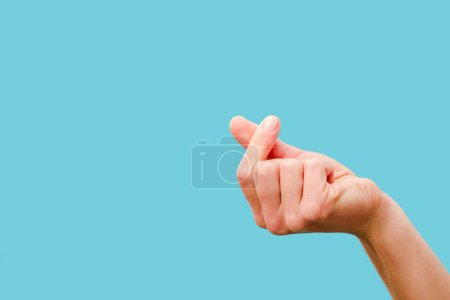 Photo for Cropped view of female hand snapping fingers isolated on blue - Royalty Free Image