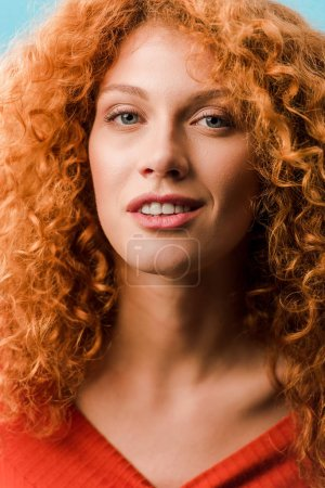 Photo for Portrait of beautiful smiling redhead woman isolated on blue - Royalty Free Image