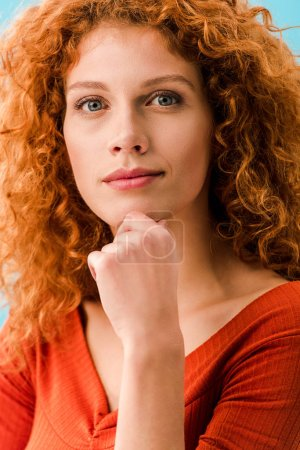Photo for Portrait of attractive thoughtful redhead girl isolated on blue - Royalty Free Image