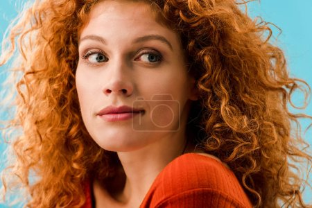 Photo for Portrait of attractive redhead woman isolated on blue - Royalty Free Image
