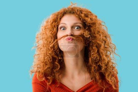 beautiful redhead girl having fun isolated on blue